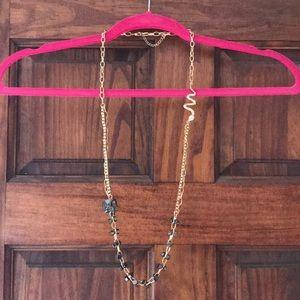 Torrid long gold-time skull/snake necklace